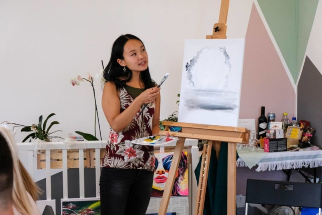 Song is showing the first steps during a guided painting session